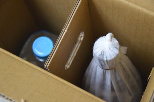 財宝温泉水ペットボトルと、芋焼酎一升瓶のお試しセット